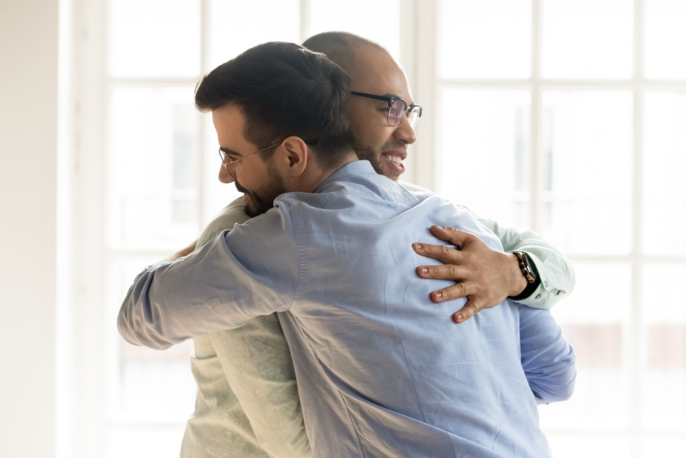 Two Males Hugging